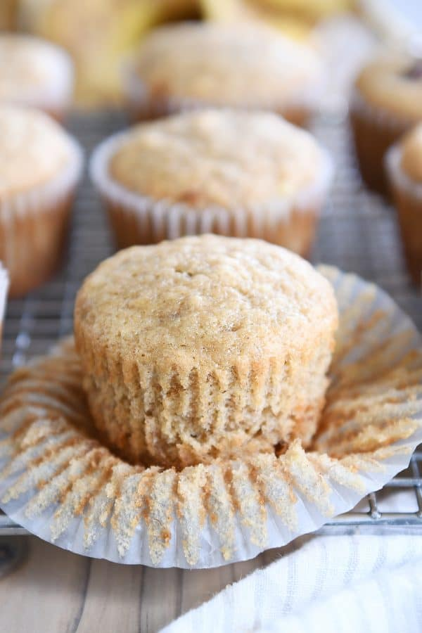 unwrapped banana muffin on wire rack