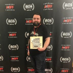 Director Sean Mannion holding our award for Outstanding Narrative Feature