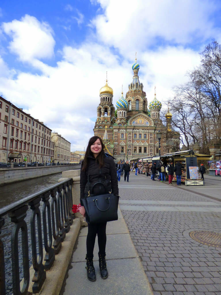 A girl standing in front of Church of the Spilled Blood