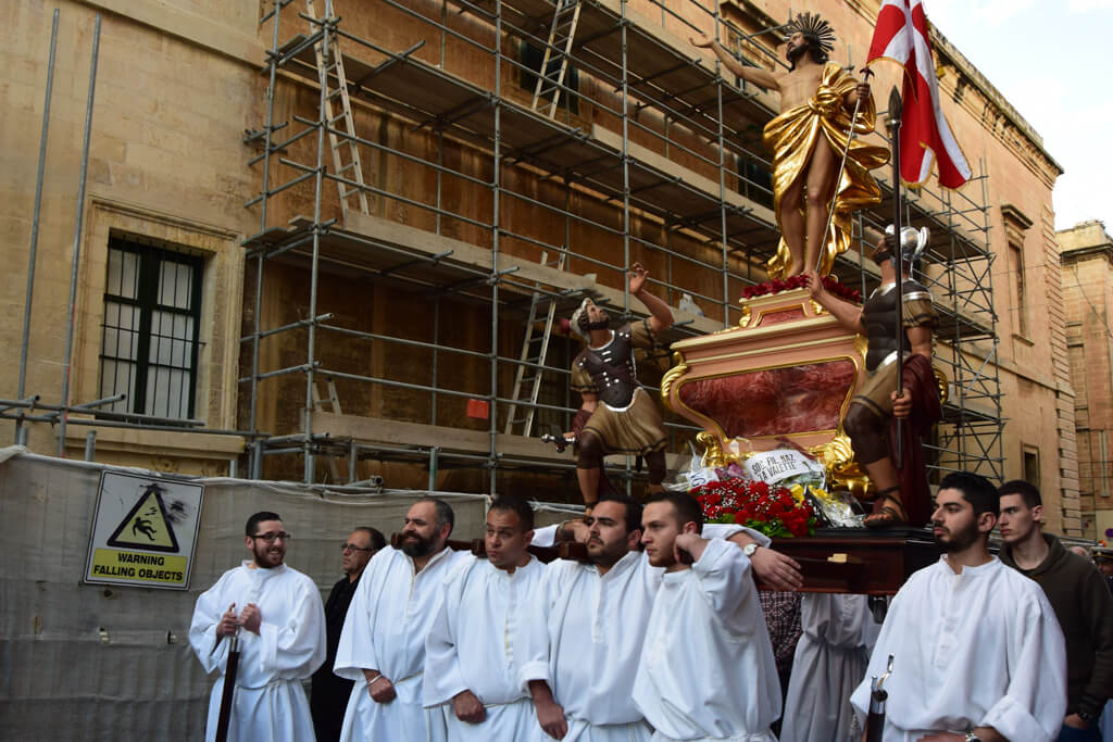 A statue of Jesus is carried through the streets of Valletta during Easter.