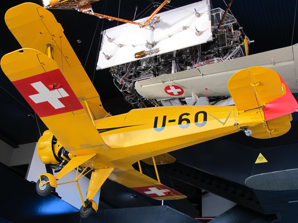 A yellow plane on display