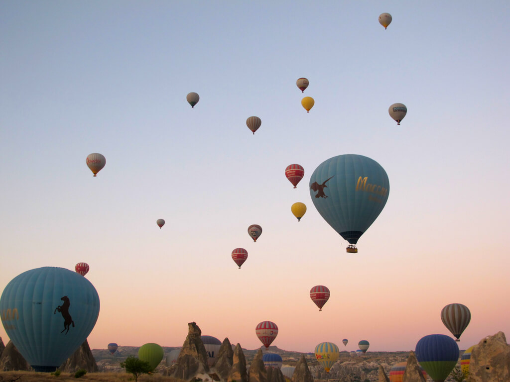 Balloons rising into the air in Cappadocia Turkey