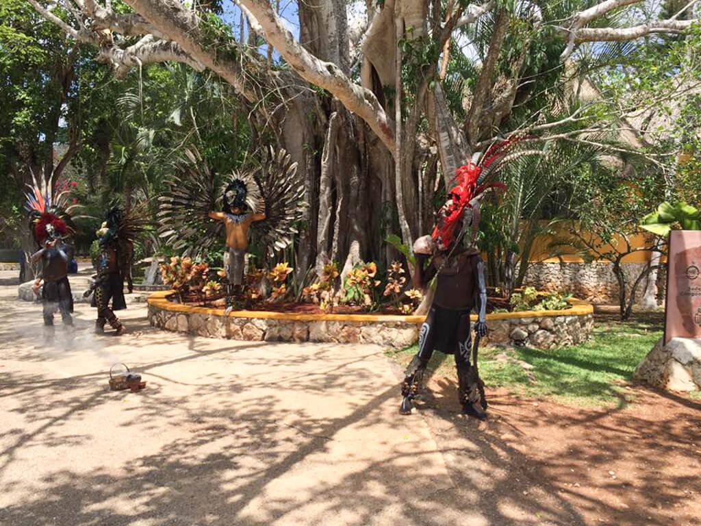 Men wearing costumes at Chichen Itza