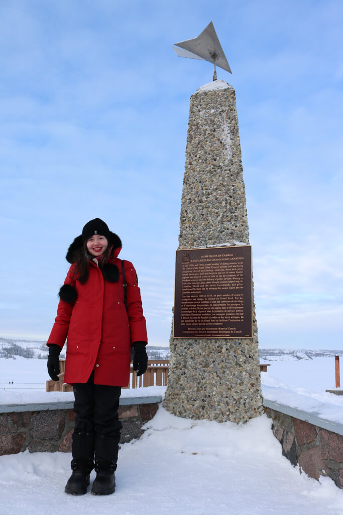 Posing in front of the Bush Pilots' Monument in Yellowknife