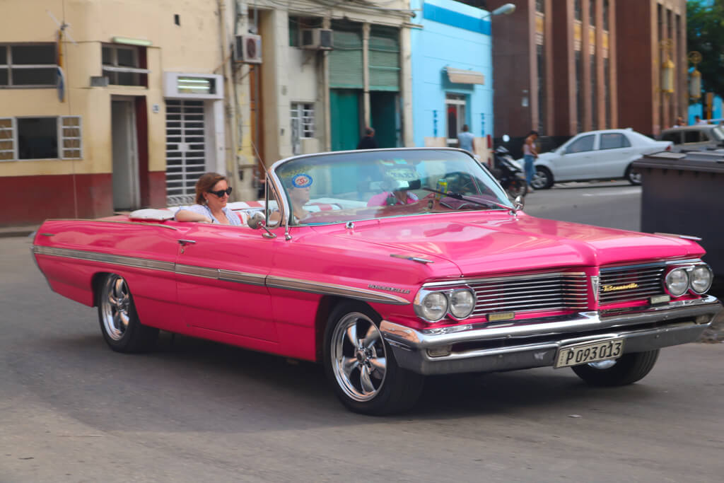 A vintage car drives through the streets of Havana, Cuba