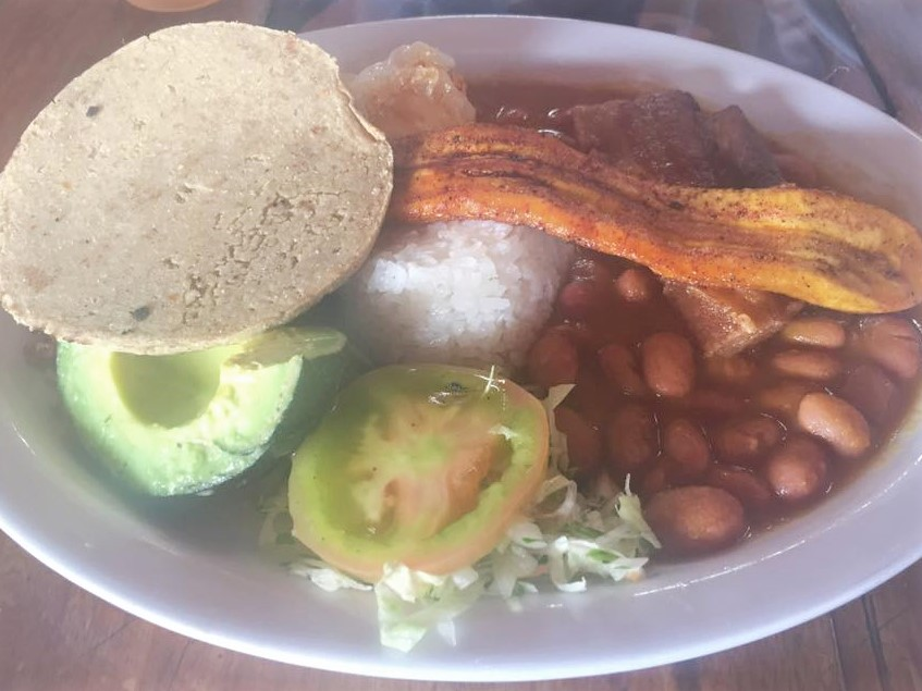 A traditional Colombian dish with beans, rice, pork, avocado and plantain