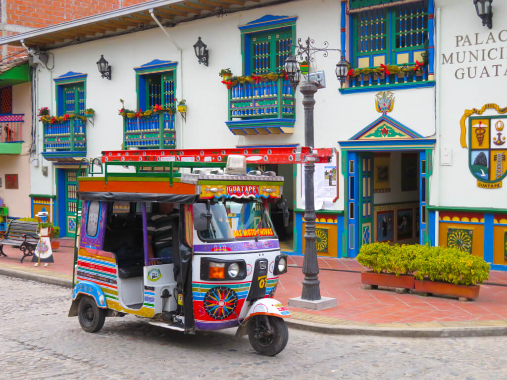 A colourful tuk-tuk in Guatape, Colombia