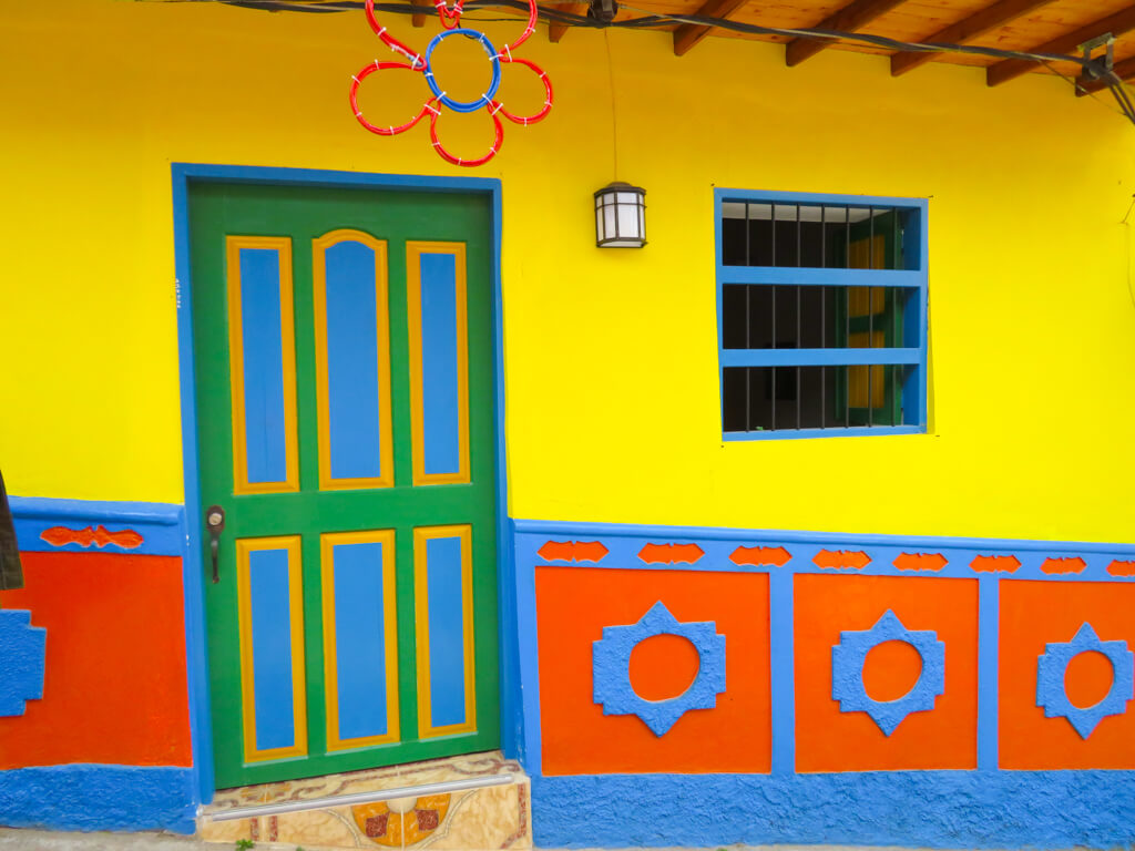 A bright yellow house in Guatape, Colombia