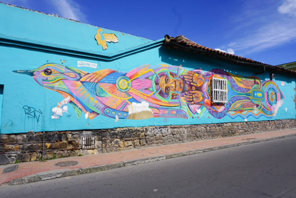 Bright street art of a bird in Bogota, Colombia's capital