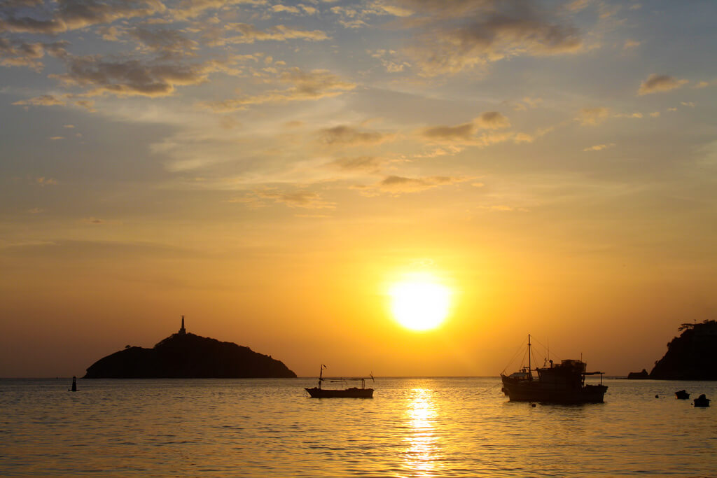 View of islands and boats at sunset in Santa Marta, Colombia