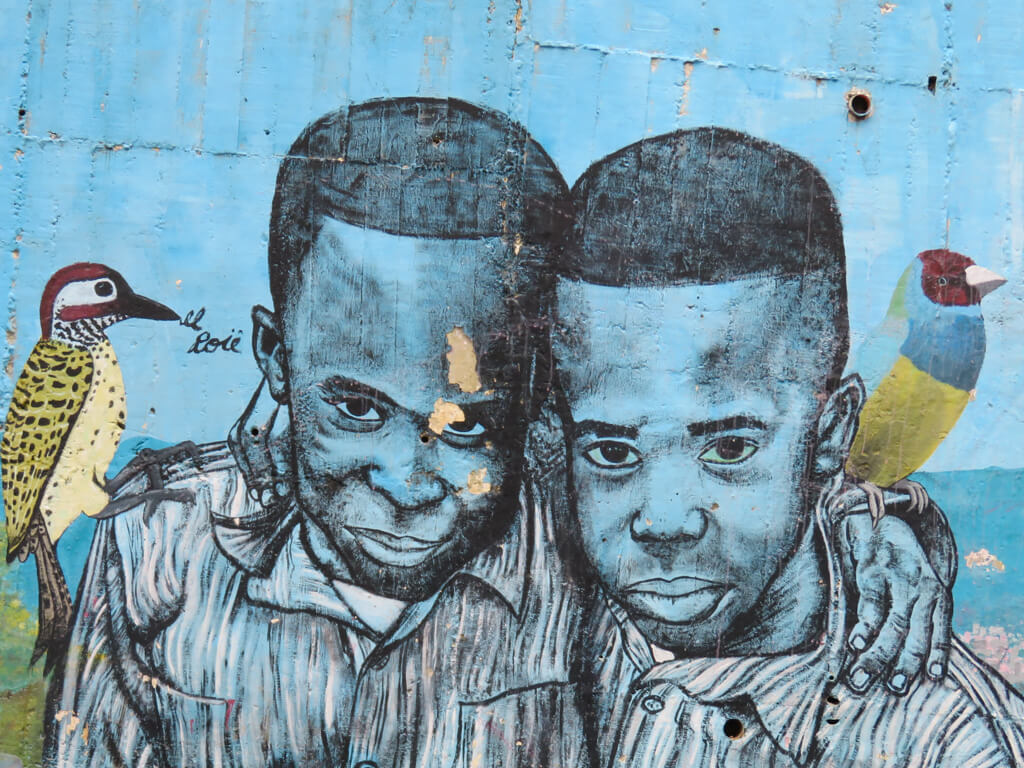 Street art of two boys and birds in Comuna 13, Medellin