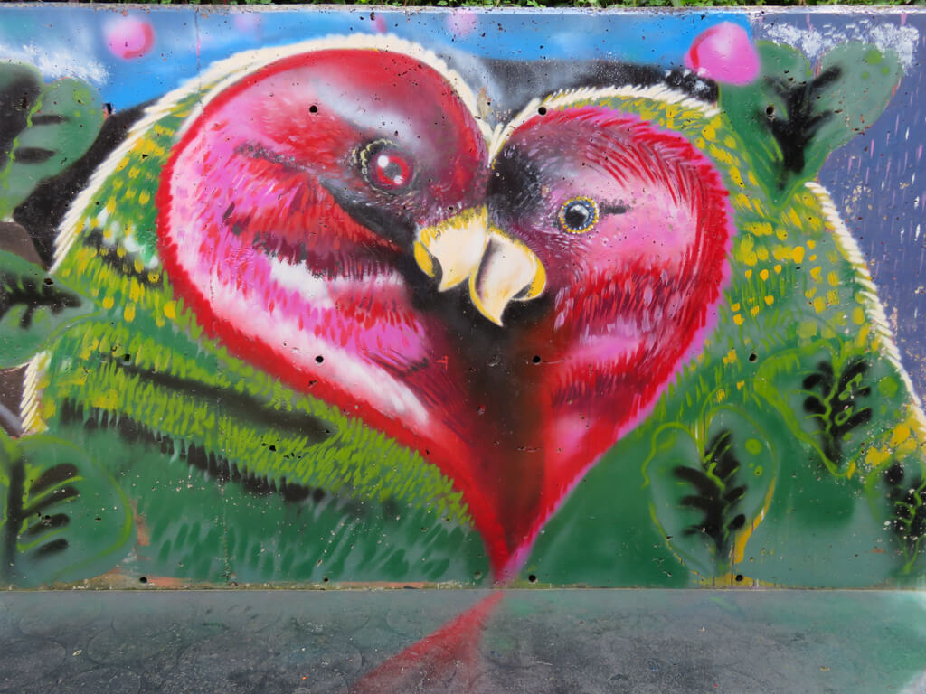 Street art of two loving birds in Comuna 13. Couples are encouraged to take a photo with them!