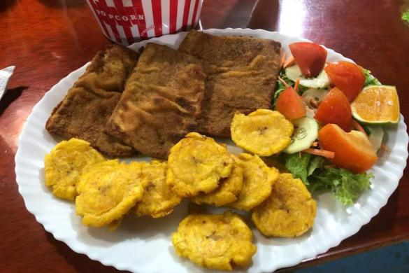 Fish served with fried plantains and salad at El Descanso Marinero restaurant on San Cristobal Island