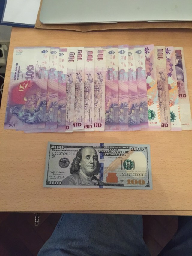 AR$ 1,500 and US $100 are shown in this picture. This is Blue Dollar exchange rate in Argentina. This is the rate people gate if they want to exchange their pesos for dollars. Why do they take a 35% loss from the official exchange rate to get US$s? They do it because the want to keep it in a currency they value.