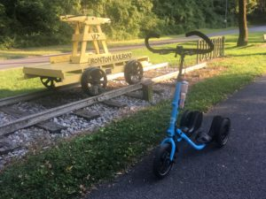 Blue Me-Mover in front of vintage yellow Ironton Railroad pump car