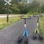 Blue and green Me-Movers next to Ironton Rail Trail sign