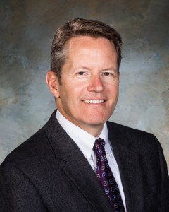Professional photo of Joel Menchey, company president.