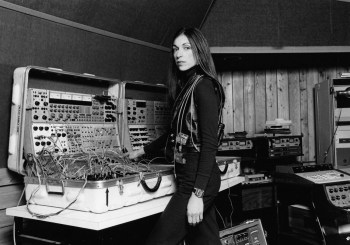 Suzanne Ciani stands in front of her analog synthesizer for picture.
