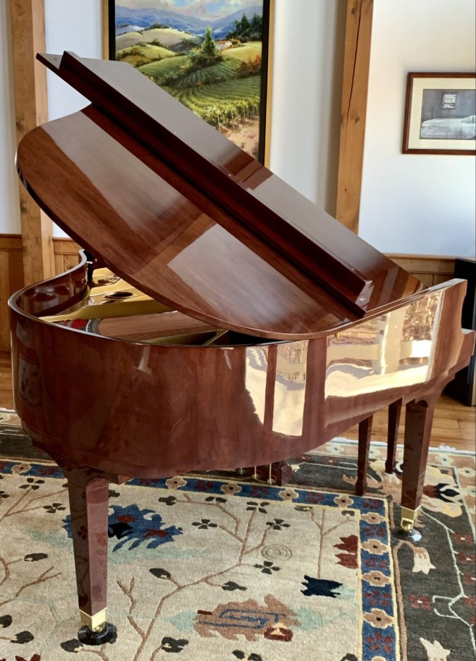 ritmuller piano view from the back in polished mahogany
