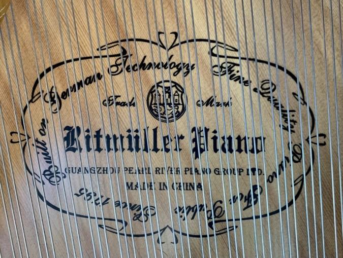 soundboard of Ritmueller grand piano with logo