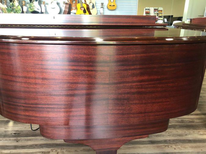 close up of satin mahogany finish for Knabe grand piano