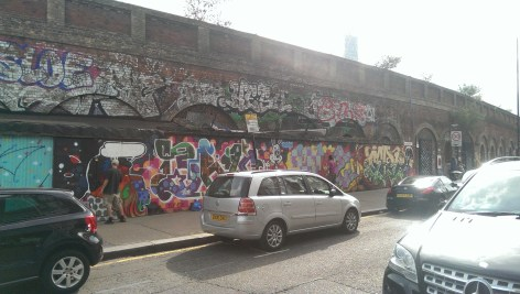 2 graffiti artists here just casually doing there thing.