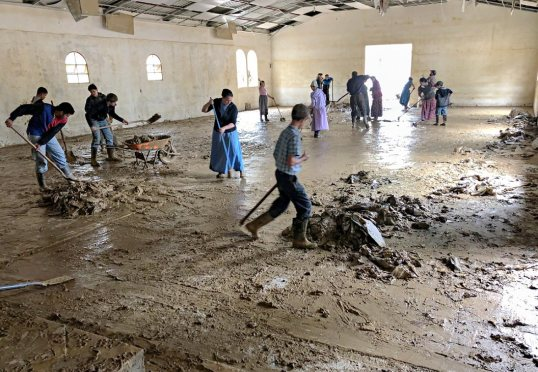 Cleaning mud out of a church building in Coban.