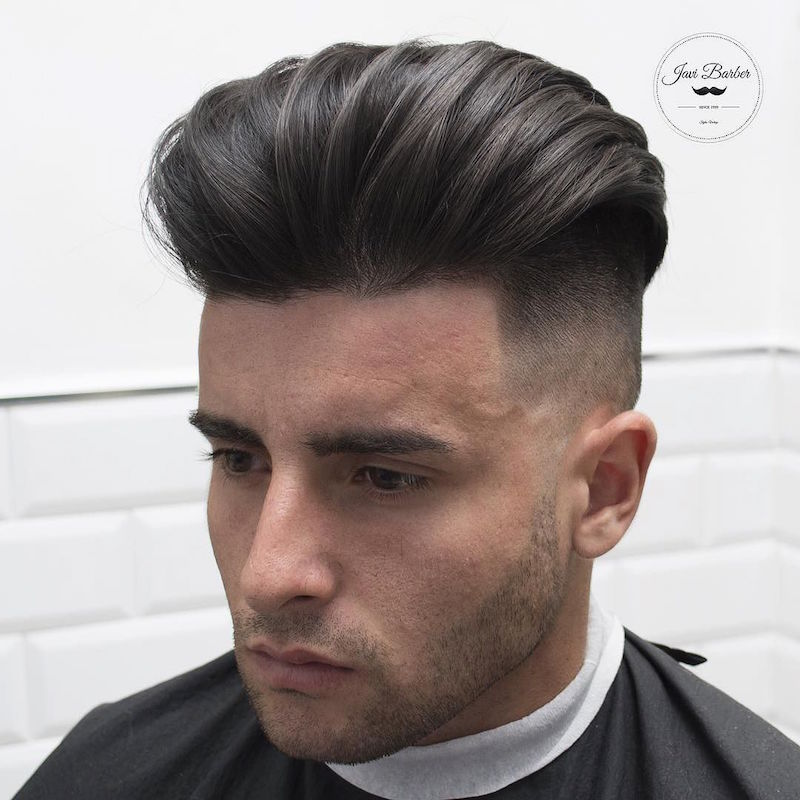 javi_thebarber__high fade and long hair slicked back dry