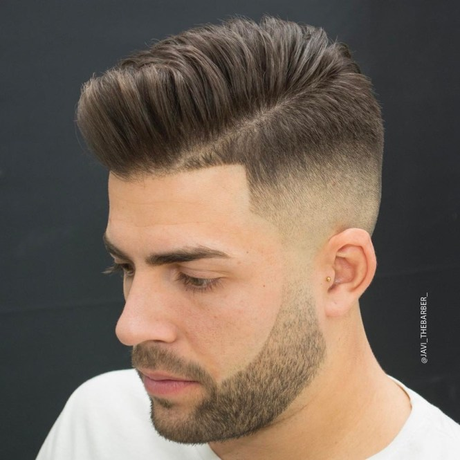 Haircuts With Parts Textured Pompadour Hard Part And High Skin Fade