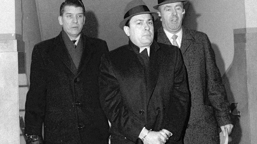 UNITED STATES - MARCH 06: Handcuffed Joe Colombo Sr. arrives at Nassau District Attorney William Cahn's Mineola, L.I., office after arrest. (Photo by Jim Mooney/NY Daily News Archive via Getty Images)