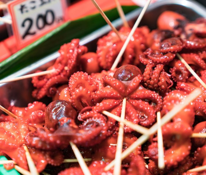 Small squid on skewers for sale at Nishiki Market, Kyoto, Japan