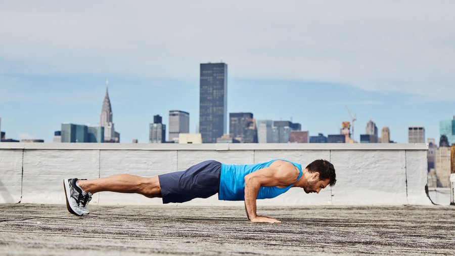 Man doing pushup on New York City rooftop