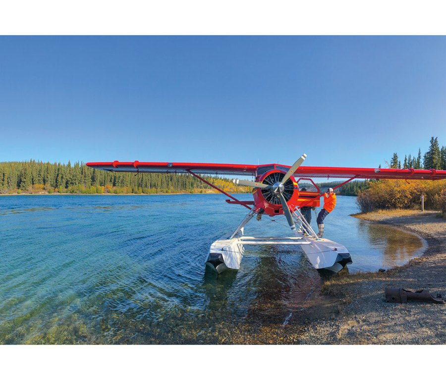 DHC-2 Beaver pontoon plane lifts off Lake Laberge.