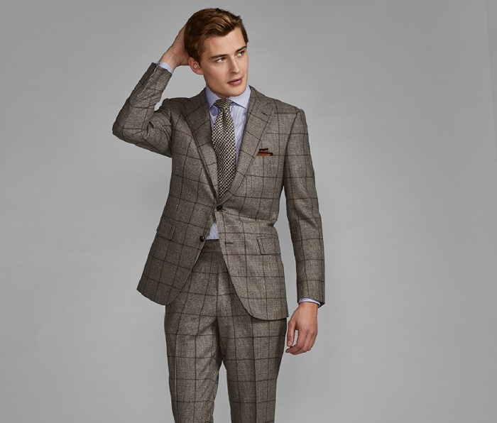 A man wearing a Paul Stuart suit.