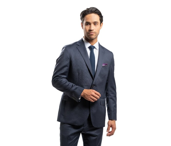 A man wearing a Peter Manning NYC suit.