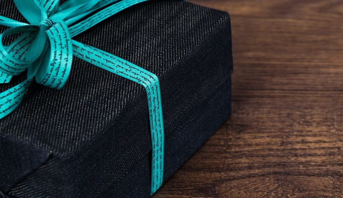 Featured image of a black gift with a teal ribbon