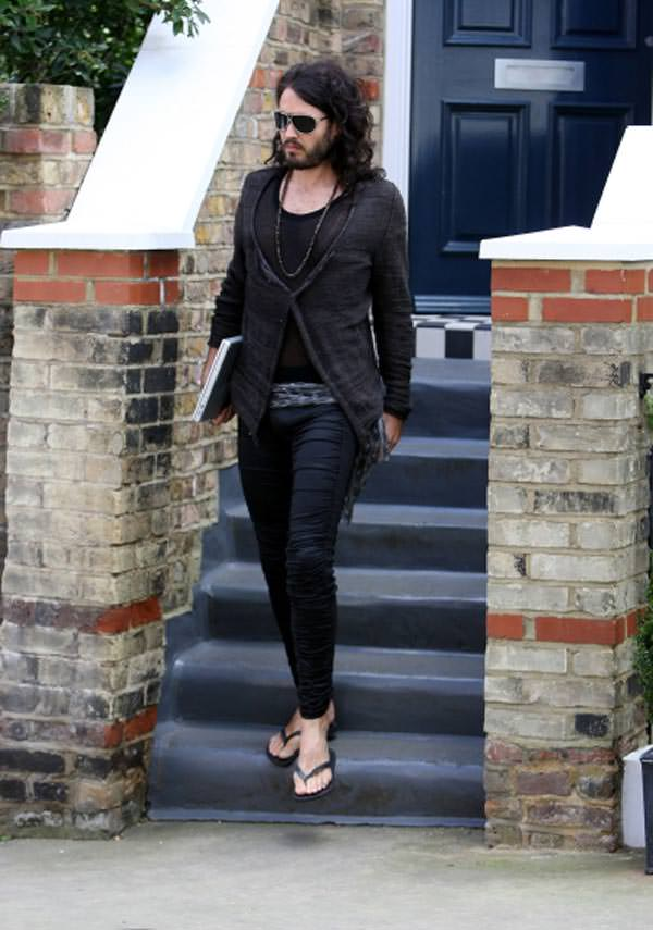 Russell Brand wearing tight black jeans
