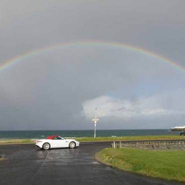 Jaguar F-type convertible causeway coastal Route Northern Ireland rainbow