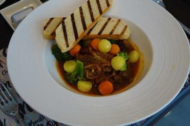 Lamb stew navarin style with fresh garden herbs