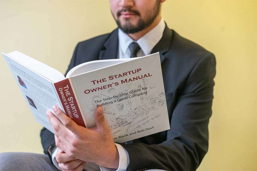 man reading book about self improvement