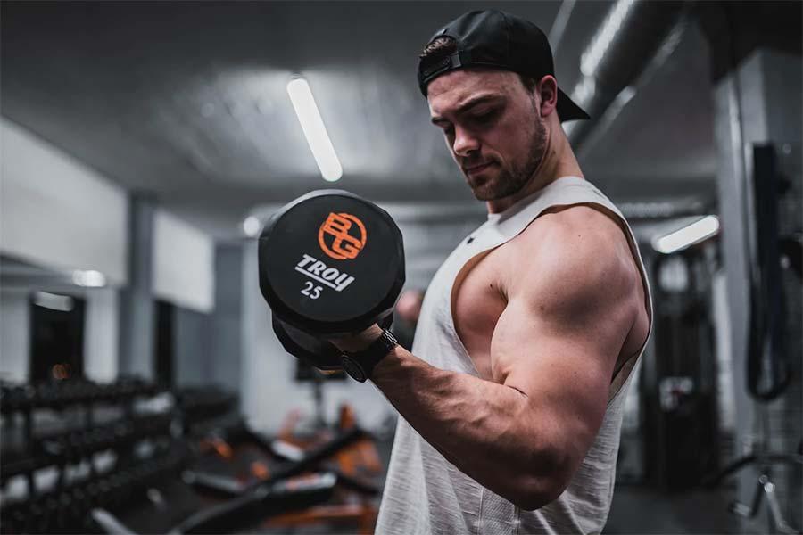 men exercise dumbbell