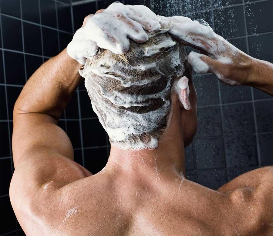 men washing his hair