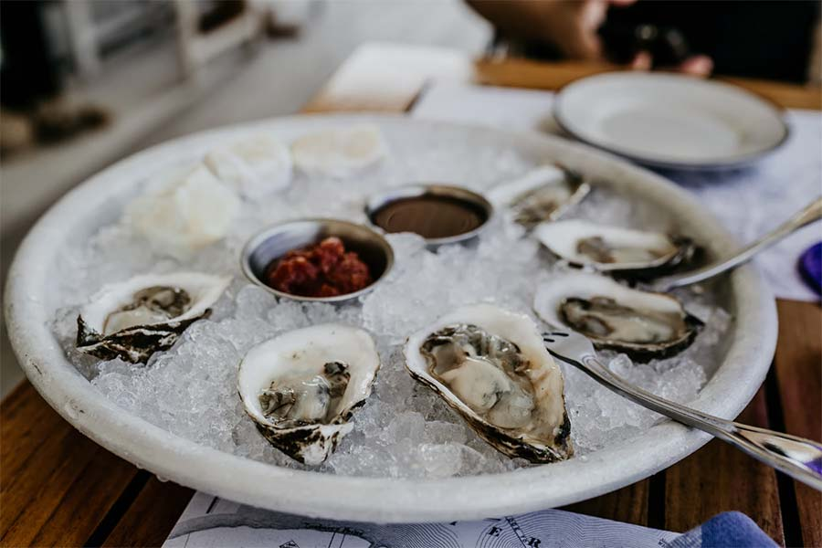 eating oysters in a restaurant