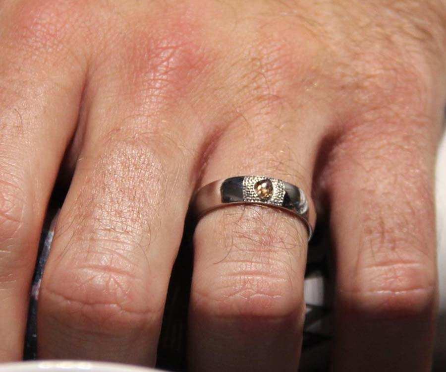 man engagement ring with precious stone