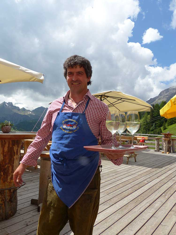 Our friendly waiter in South Tyrol with Hugo cocktails.