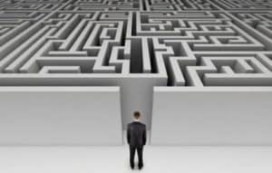Simple person facing many simple challenges. Facing a maze, one door to enter then many avenues to choose from