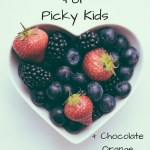 Heart shaped bowl full of fruit with text overlay - More top tips for picky kids