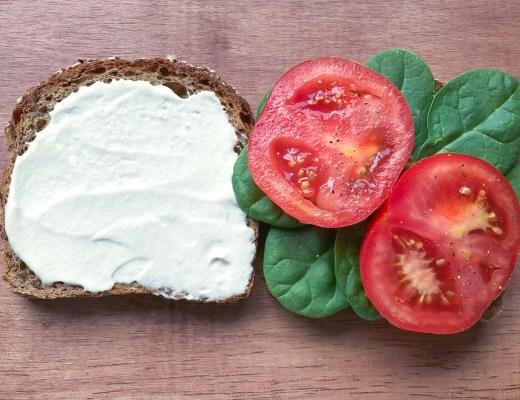 Open sandwich slathered with vegan mayo