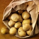 overflowing bag of potatos