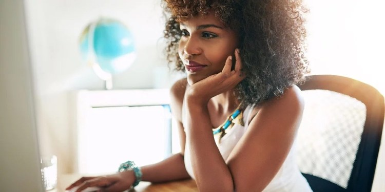 a black lady resting her chin on her hand